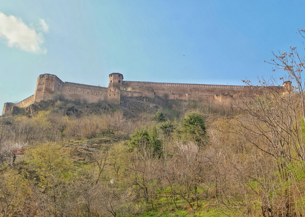 The Hari Parbat Fort as seen from the Badamwari below