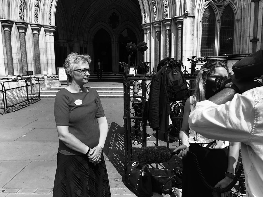 Dr Jenny Vaughan giving an interview outside the Royal Courts of Justice as Dr Hadiza Bawa Garba's appeal