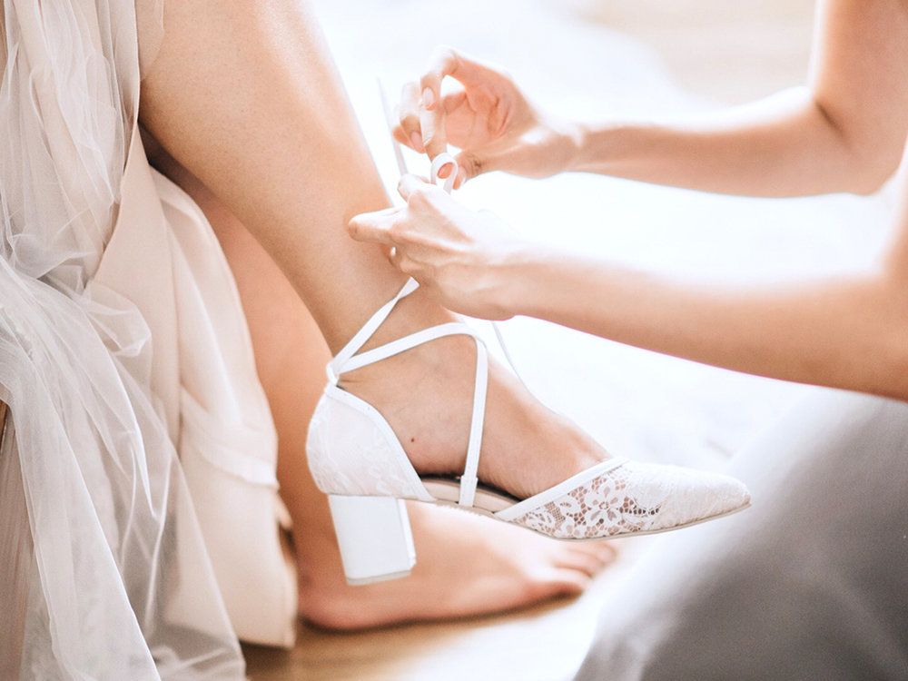 """(Thank you) Jefferson Si for the one-of-a kind bridal shoes. Our coordinator kept asking me if I wanted go slip into slippers during the reception and I kept saying no. I loved how you incorporated lace and lambskin into a design that was feminine and comfortable. I wore them for our first dance also! They are fantastic! Thank you for my dream wedding shoes!"""""""