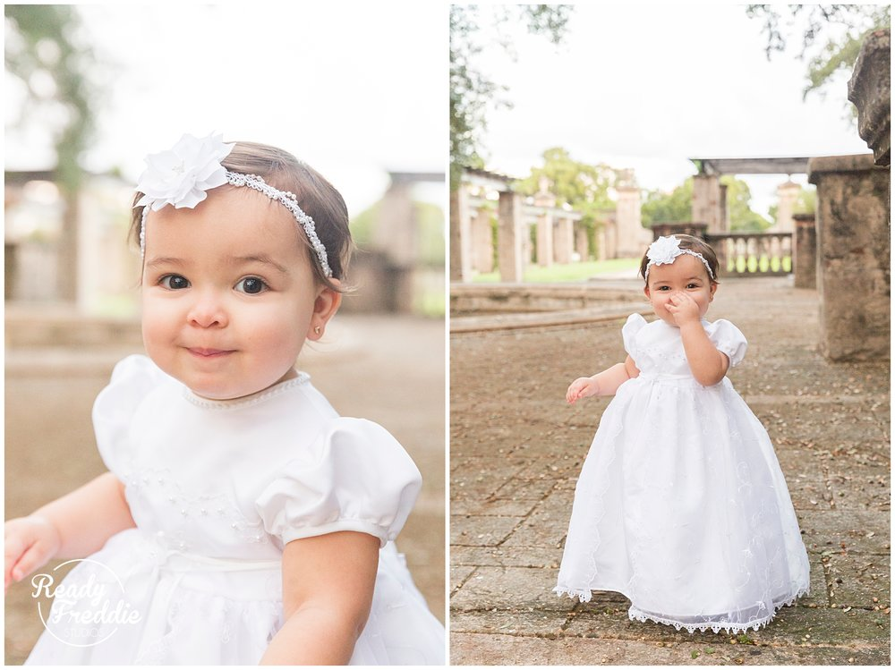 Girl in baptism gown standing