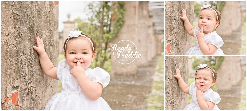 Cute faces by girl in baptism gown in coral gables