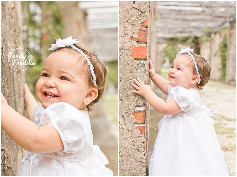 cutest smile from girl taking baptism pictures