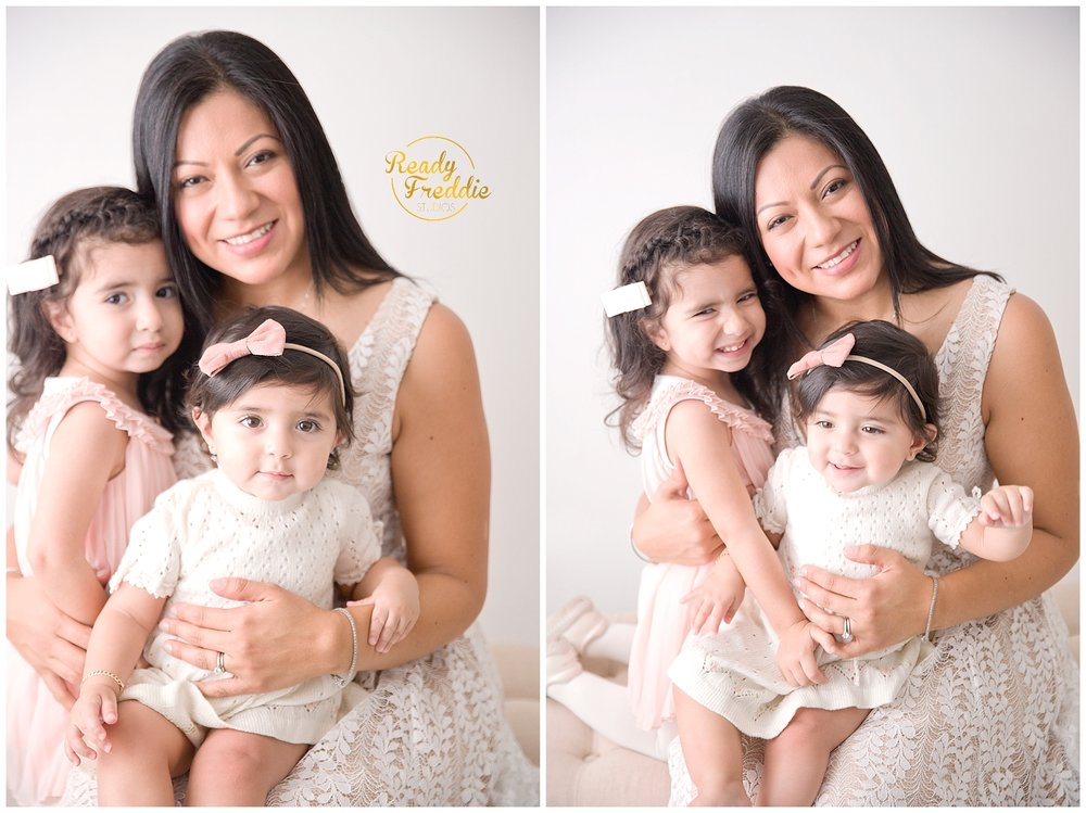 Mom holding both her daughters smiling and enjoying her session in Miami Photo Studio