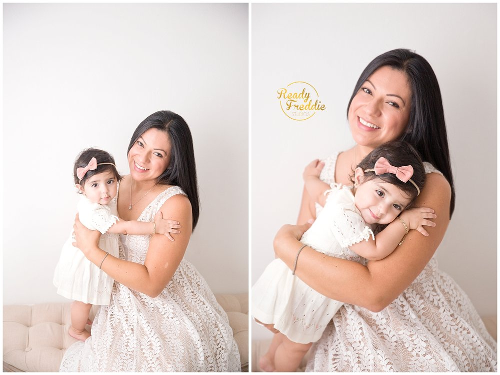 Mommy and me pictures with mother holding daughter during session at luxury miami studio
