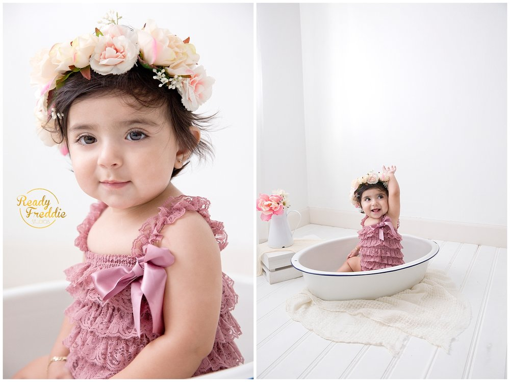 baby girl during her one year pictures with floral crown in a vintage bath tub in Miami Photography Studio
