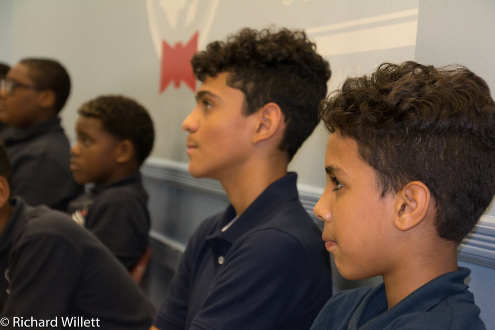 - Juan Oquendo and Roberto Santana listen intently to Mr. Morris' remarks.