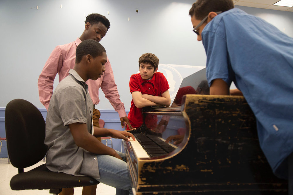 - Students review their keyboard skills with graduate Michael Williams