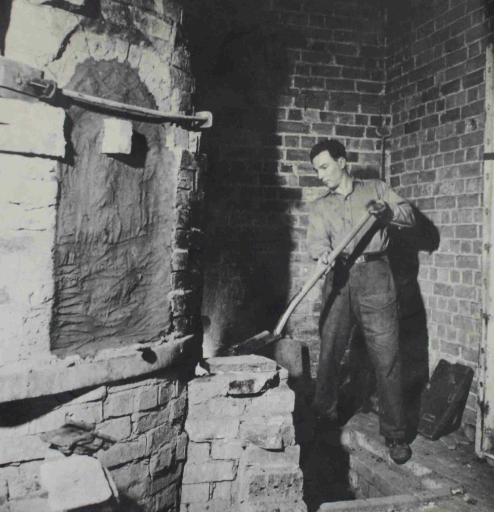 Charlie Tustin stoking the bottle kiln.Image courtesy of John Edgeler of the  Winchcombe Archive Collection.