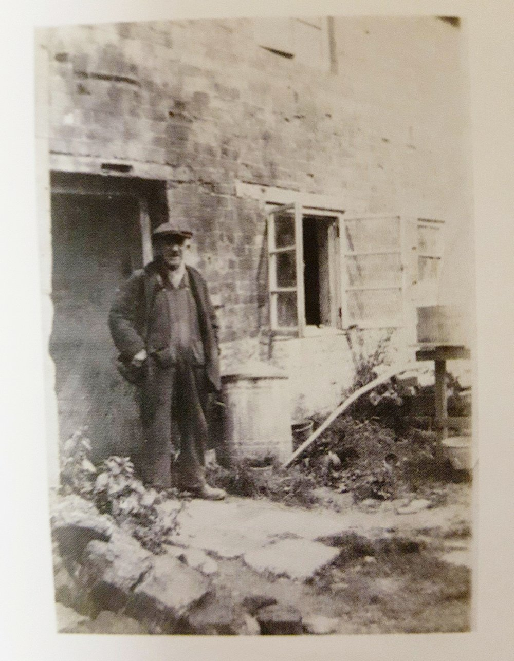 Elijah Comfort at the door of the pottery. He was known to throw in a shirt, with a pipe hanging from his mouth. Image courtesy of Matt Grimmitt.