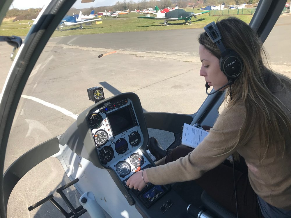 Female pilot starting up helicopter