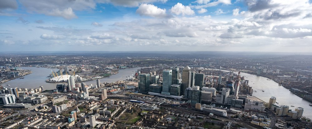 Flying over Canary wharf and the O2 arena in east London
