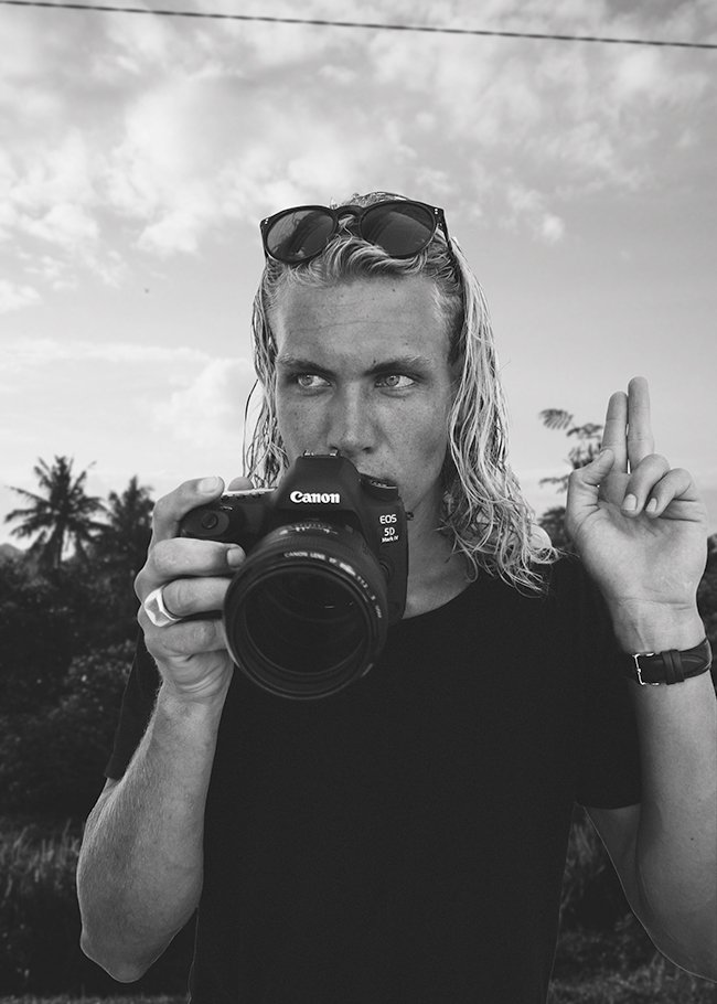 Morgan McDougall reviews 'The Best Travel Cameras of 2018' holding the Canon 5D Mark IV somewhere in Bali.