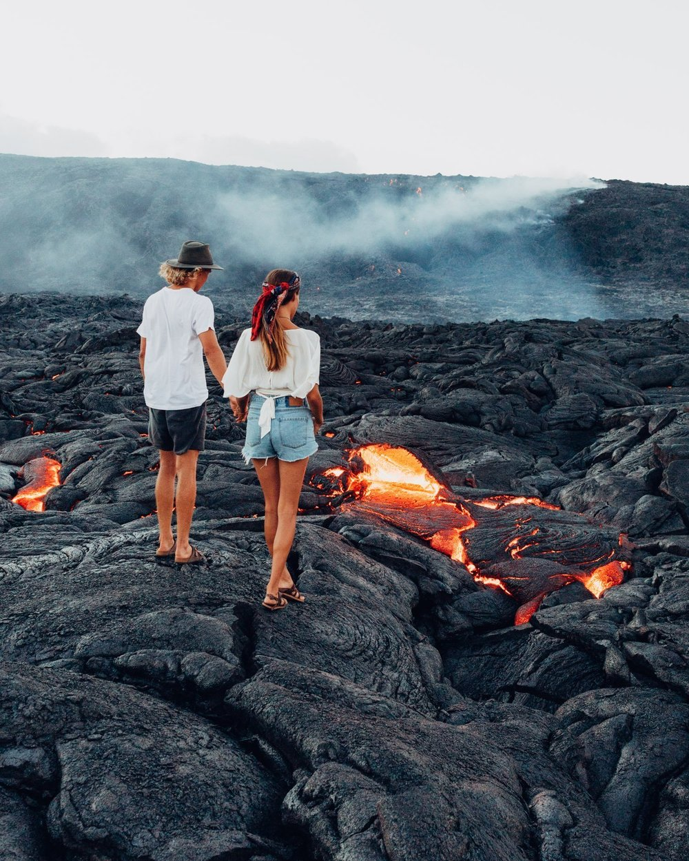 Cosmos Companions Tahnee Pinches and Morgan McDougall hiking in the Volcano National Park on the Big Island of Hawaii.