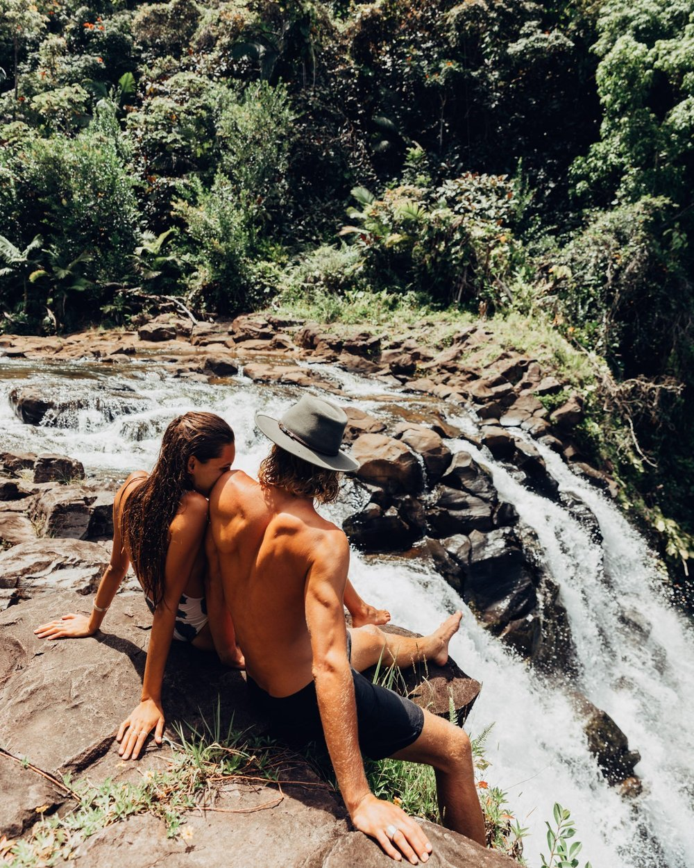 Tahnee Pinches and Morgan McDougall Cosmos Companions at a waterfall on the Big Island in Hawaii.