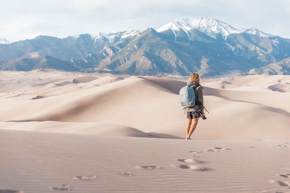Morgan McDougall from Cosmos Companions hiking Great Sand Dunes National Park, Colorado, USA.