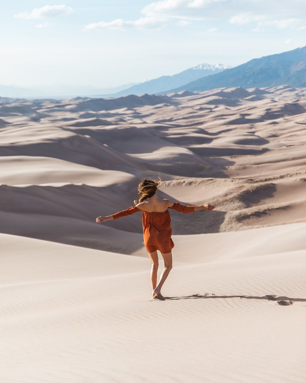 Tahnee Pinches, shot by Morgan McDougall from Cosmos Companions dancing in the Great Sand Dunes National Park, Colorado.