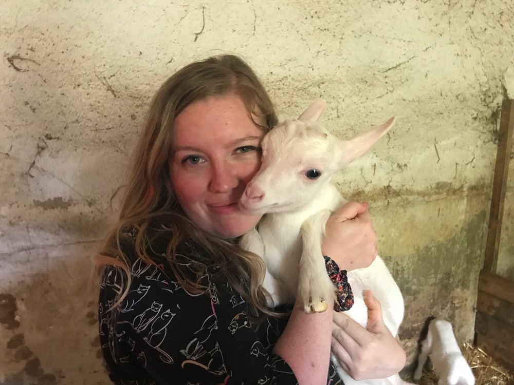 Director Emily Cumming with a baby goat