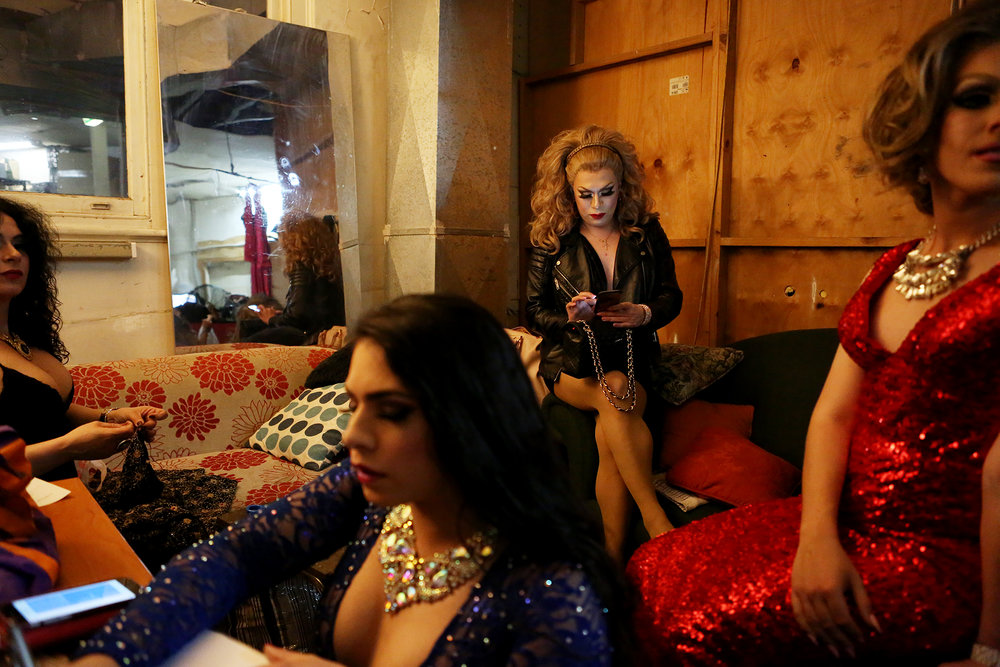 Performers wait backstage before their debut at Trans Glamoré.