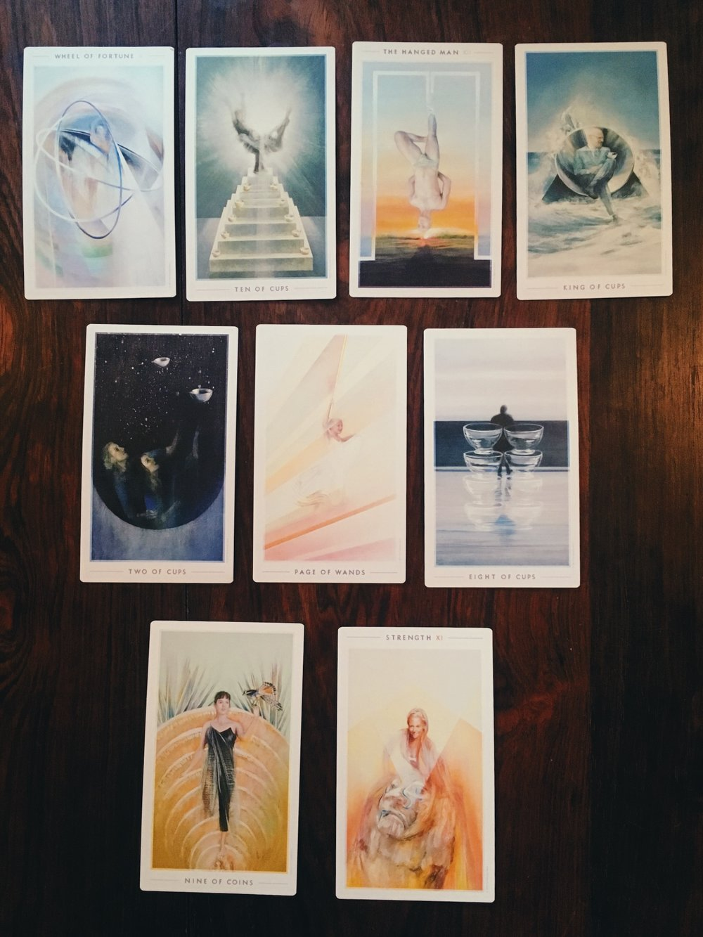 the reading I received almost a year ago with nine of pentacles, strength, and eight of cups all making an appearance!