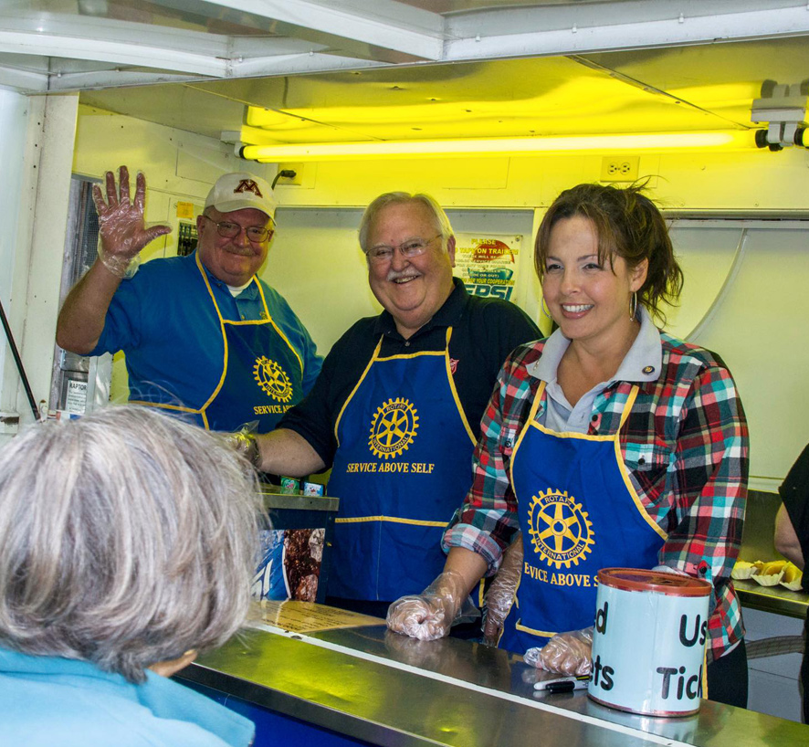 Heather serving with The Rotary Club of Rochester at Quarry Hill Fall Festival.