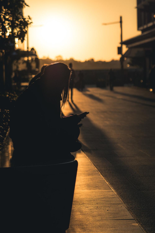Girl alone on phone