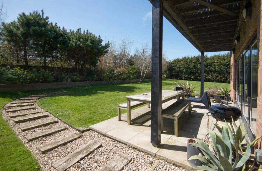 Beach Haven has a large garden with BBQ and outside dining table.