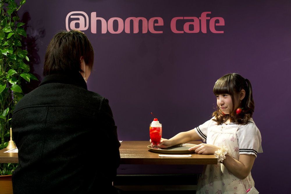 "The @Home Café, Akihabara, Tokyo, Japan  At this café young women dress in uniforms inspired by the garb worn by a traditional French maid. As patrons walk through the door they are greeted with a cry of ""Welcome home, Master!"" A variety of foods and services- including massages, ear cleanings, rock paper scissors competitions, and board games are offered by smiling ""maids.""  Japan's population is expected to drop from 127 million in 2014 to 87 million in 2060."