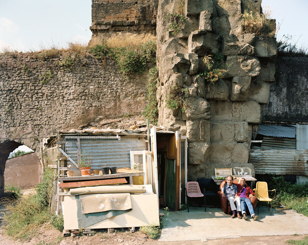 Two people living under the Claudian Aqueduct at the point where