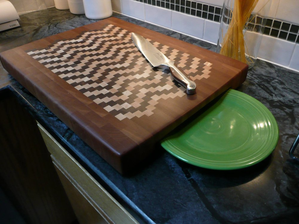 Chef Pro Series Cutting Boards - This cutting board innovation was developed by KND several years ago. It is the only sculpted, sloped-to-drain cutting board available anywhere today. It's unique design directs all liquids and juices towards the center and off the end of the board. You can either catch them on your serving platter/plate or let the board overhang your sink for drainage. This innovative design totally eliminates the need for those messy, hard to clean and maintain juice grooves!