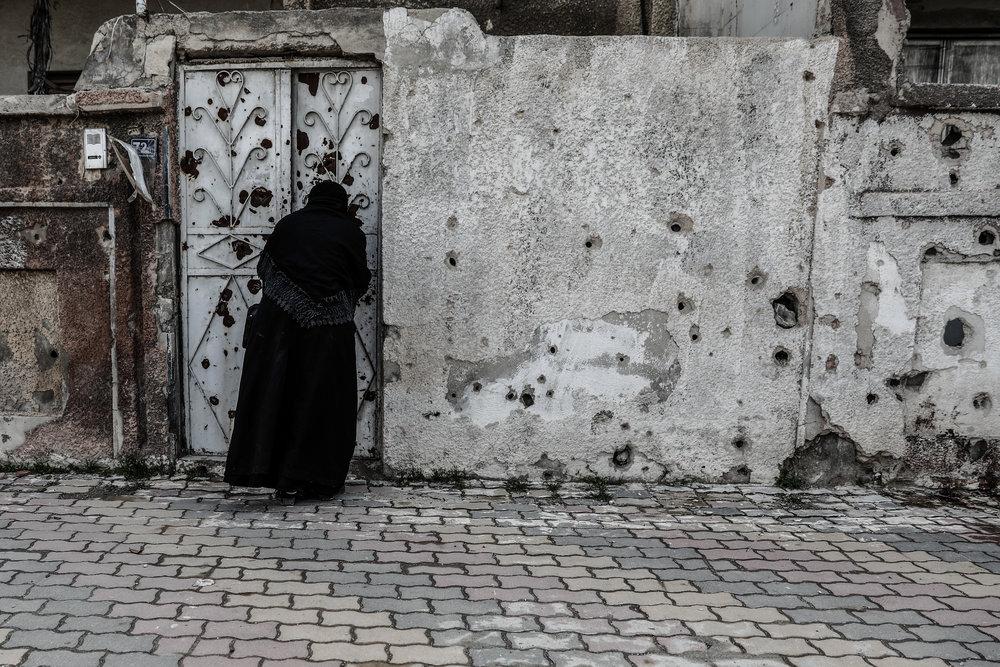 - Umm Mohammed, arrives at a literacy school.