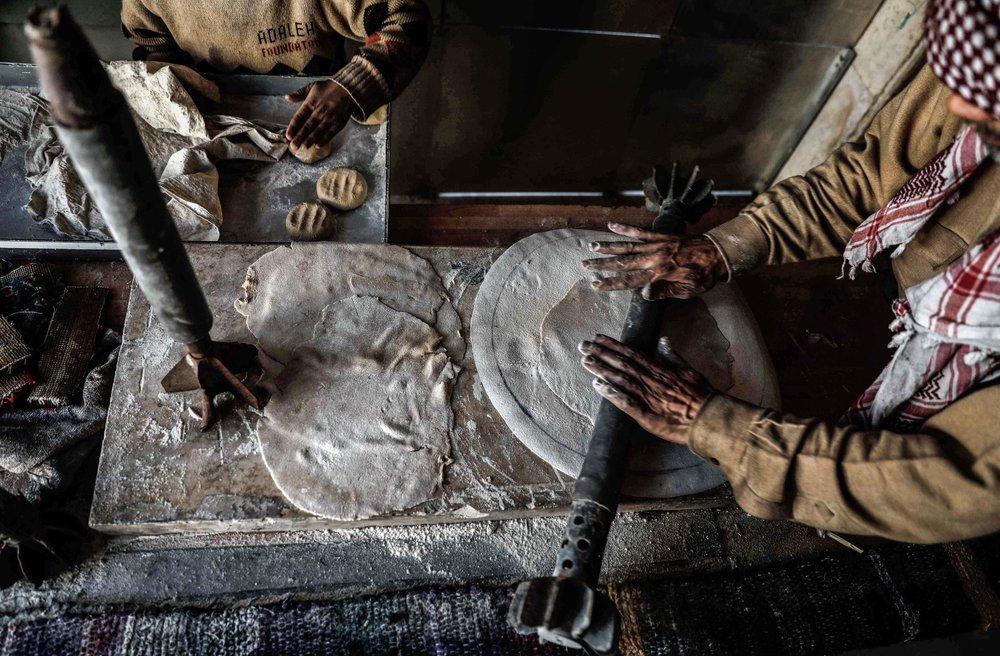 - Abu Ali al-Bitar, a 45-year-old house painter who collected dozens of rocket debris and spent ammunition casings, flattens bread dough using a leftover rocket in the city of Douma.