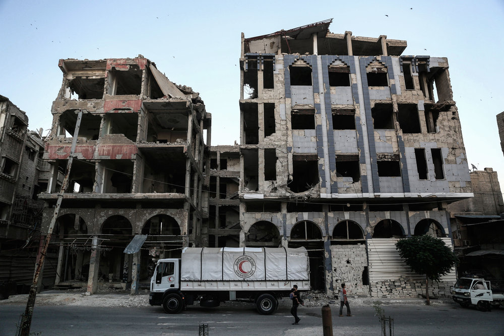 A Syrian Arab Red Crescent lorry is seen parked in the city of Douma. During the hardest period of siege a few convoys entered Eastern Ghouta after more than 10 months of the intensified siege and the aid do not cover the need of 10% ؜ of the population of Ghouta for a week.