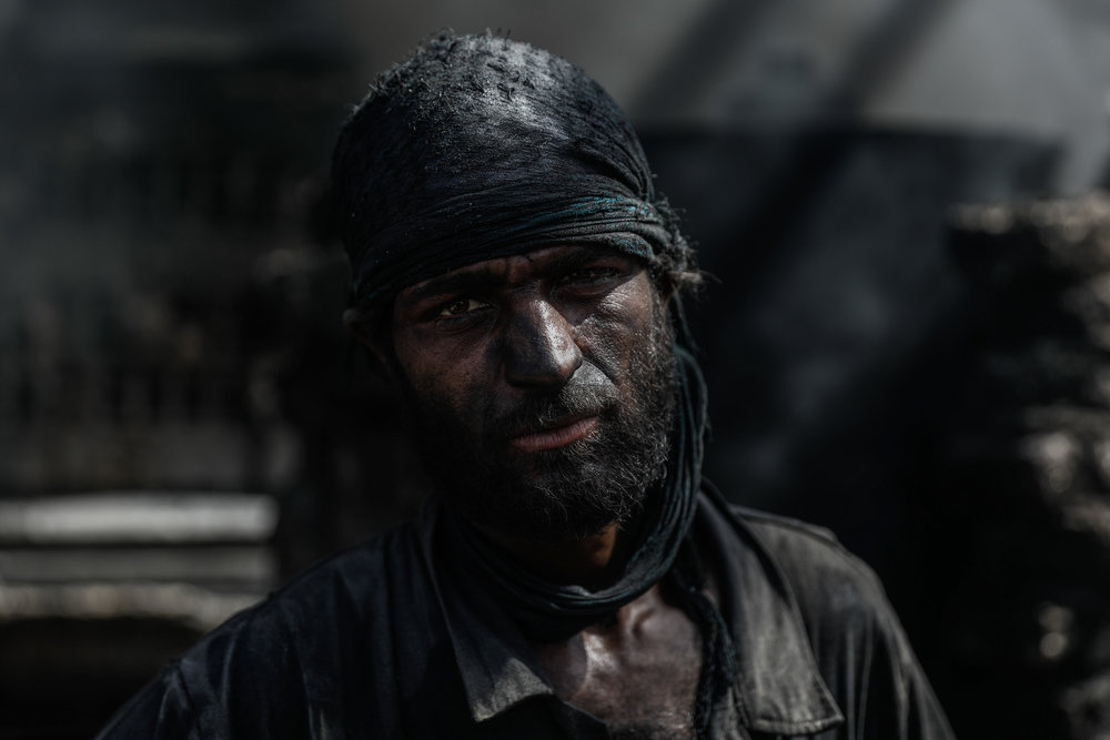 Abu Fahed, poses for a picture at a workshop produces fuel and gas from plastic in the city of Douma.