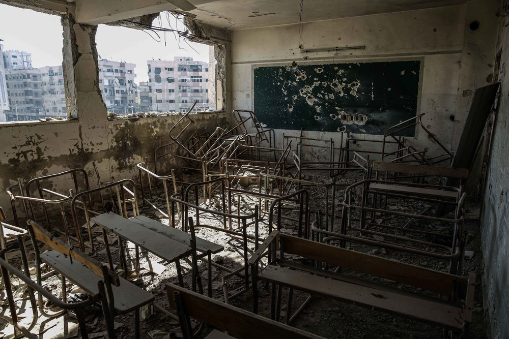 - A picture shows a damaged classroom following an airstrike by the Syrian government forces on the city of Douma.