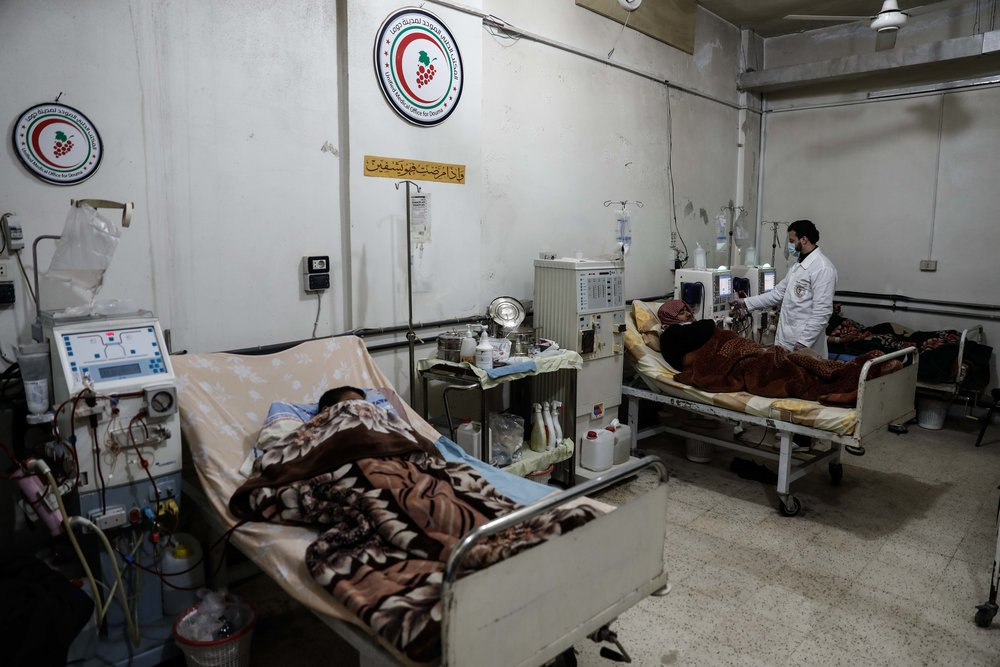 - Kidney specialist Mohamed Sadeq, a 34-year-old Syrian physician, attends to his patient, who suffers from renal insufficiency, as he undergoes treatment in the basement-turned-clinic in the city of Douma.