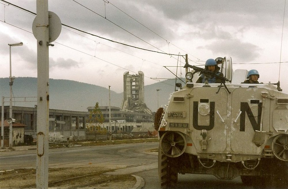 "UN troops on their way up ""Sniper Alley"" in Sarajevo. From    Wikipedia   ."