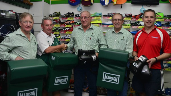 CYMS Rugby League football club representative Norman O'Neill (second from left) receives the new training gear from CYMS Old Boys Kel Brown, Bryan O'Sullivan and Barry O'Connor and Dubbo Sports Power's Anthony Barnes. Photo: BELINDA SOOLE