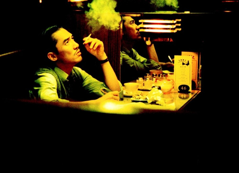 圖片說明:電影《2046》劇照,戲中梁朝偉飾演的作家周慕雲是以劉以鬯作藍本