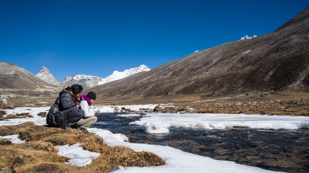 A semi-frozen Lachung river at Yumesamdong Zero Point