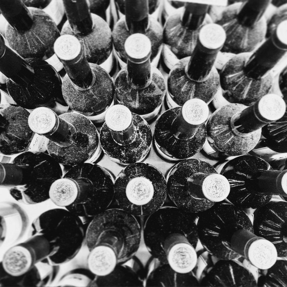 Dusty bottles of wine