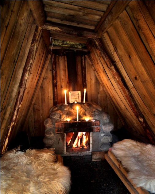 Two beds with sheep skins for sleeping bags, and a fire place to keep you warm. What else do you need?