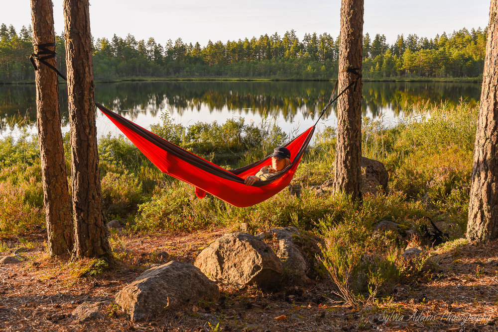 Our guest Sarah relaxing in the hammock during a Wolf tour. Photo: Sylvia Adams