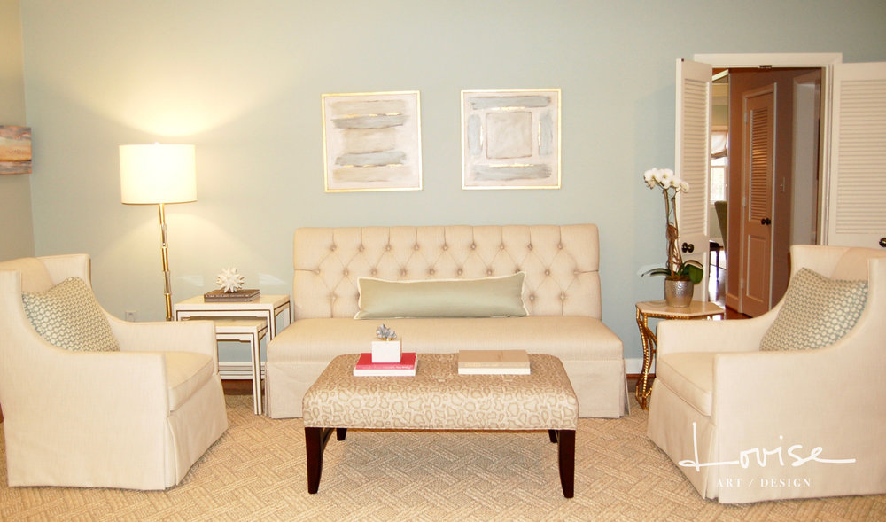 Neutral living room with snakeskin ottoman and custom banquette