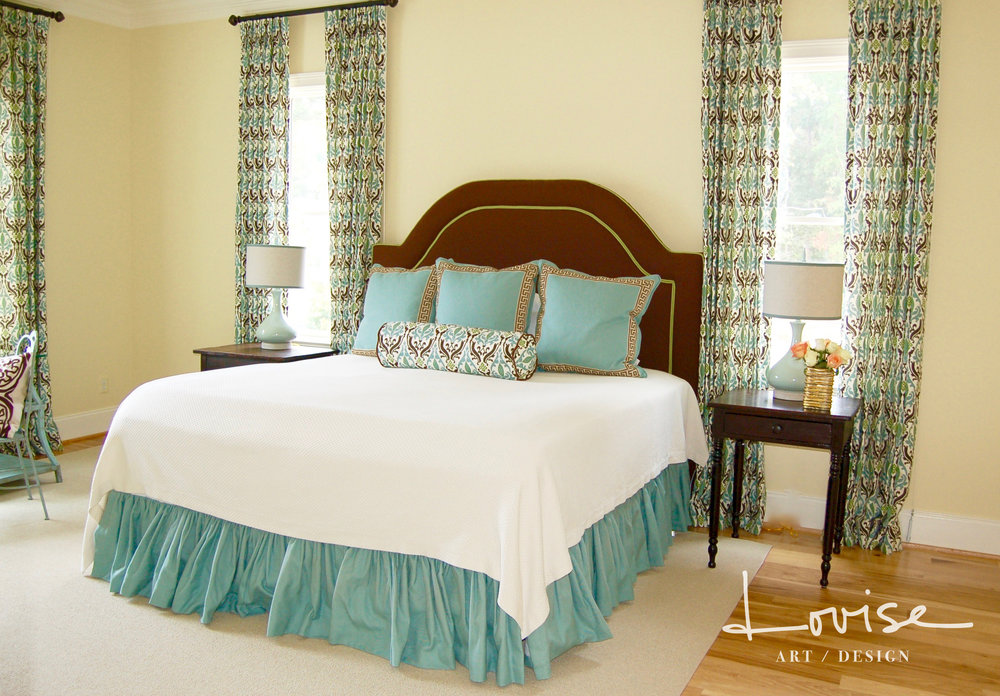 Casual bedroom with aqua and chartreuse details and custom headboard