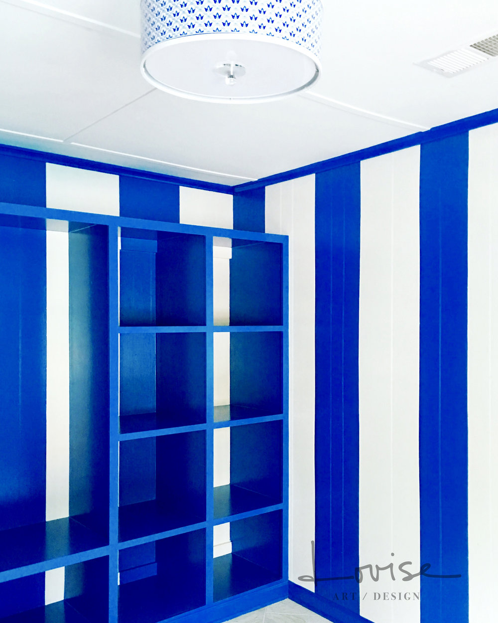 Pool house stripes in royal blue with French Provencal light fixture