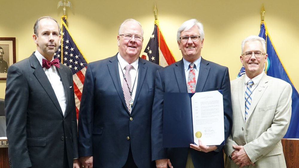 Clermont County Commissioners proclaim May 2018 as Leadership Month. From left to right: Commissioner David Uible, Commissioner Ed Humphrey, LEAD Clermont Academy Executive Director Bob Pautke and Commissioner David Painter.