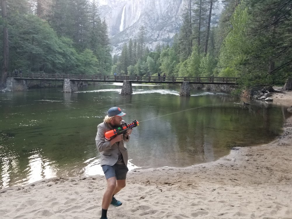 Seeker acting a foo with Yosemite Falls in the background