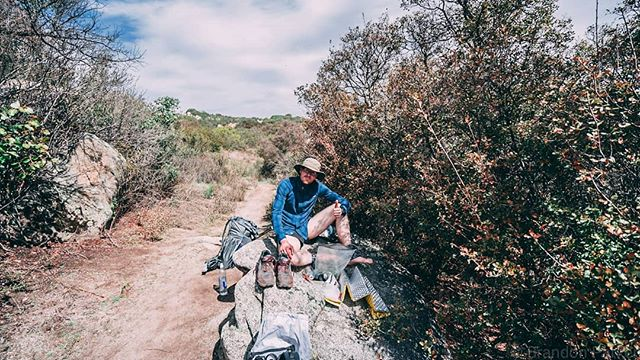 Those day one feels. Tags and I finding some tiny little bit of shade to eat lunch on our race away from the border. #humansofthepct #PCT #pct2018 #sonyalpha #sonya7ii #adventurephotography