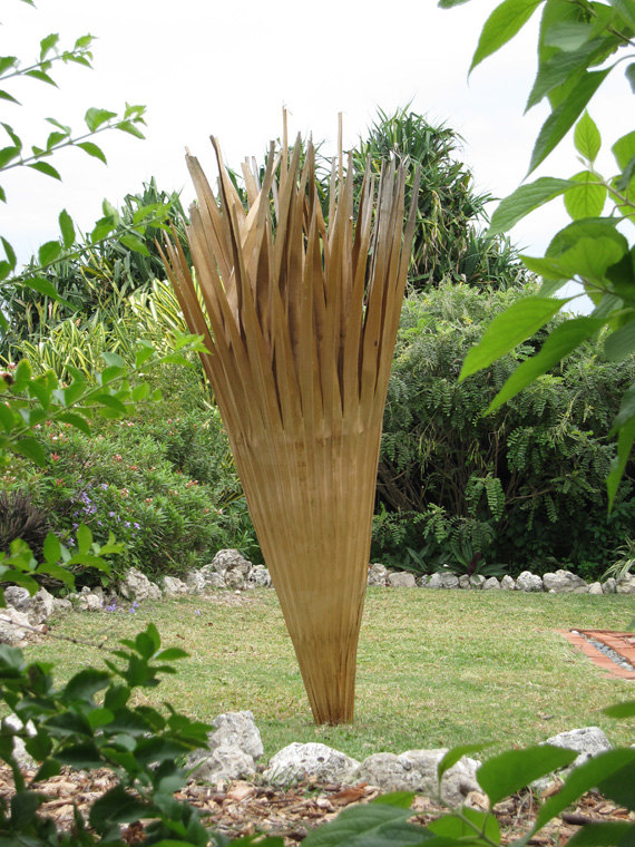 "Large palm leaf trumpet (reinforced version), double leaf construction with split rattan interior and exterior ribs and reinforcement with palm fiber and sponge, sealed with oils and resins, 67"" L x 16"" largest diameter."