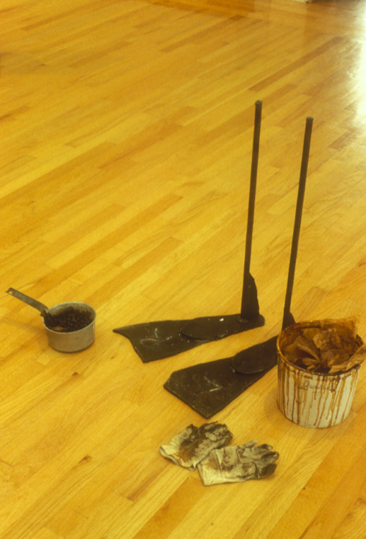"""OBJECTS MADE TO MAKE OTHER OBJECTS  1994  Aluminum pan with kelp, steel molds, work gloves, plastic pail with shellaced synthetic felt, 3' x 20"""" x 2'"""